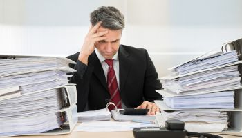 Headaches and hopes of corner office