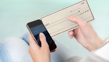 Fed: Mobile banking, payments gained in 2013