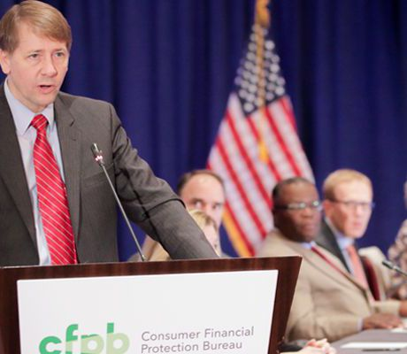 Looking on as Cordray steps down